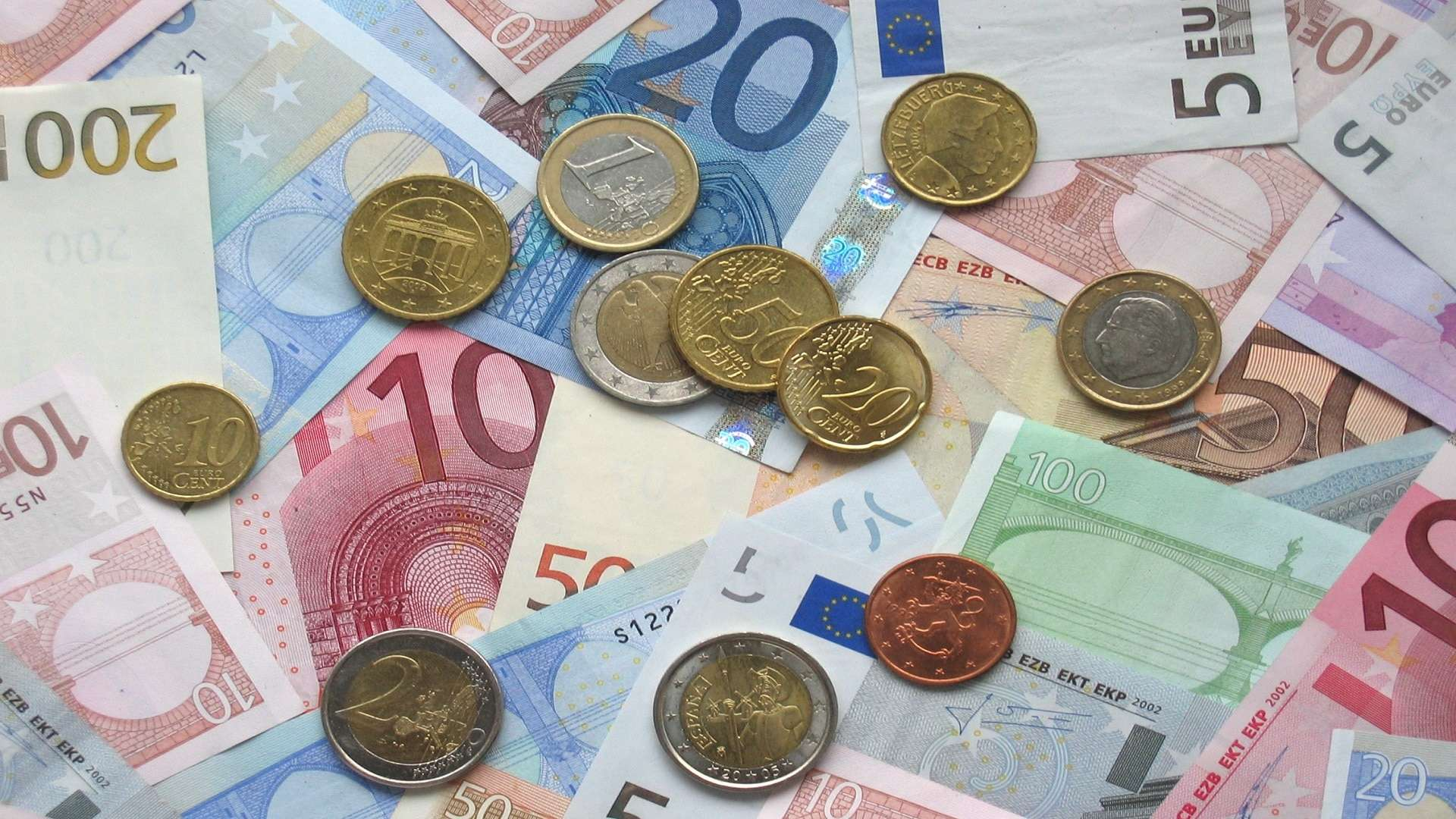 Canva - Banknotes and Coins